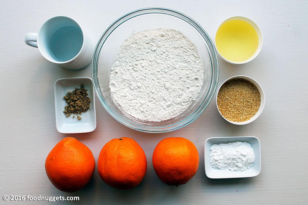 Acqua, farina, olio di semi di mais, zucchero di canna, zenzero in polvere, lievito istantaneo, arance
